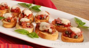 Bruschetta with Tomatoes Cheese and Prosciutto