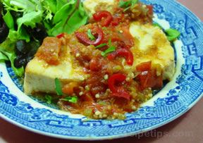 fish poached in salsa Recipe