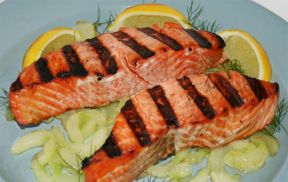 Grilled Salmon on Saut#195#169ed Cucumbers