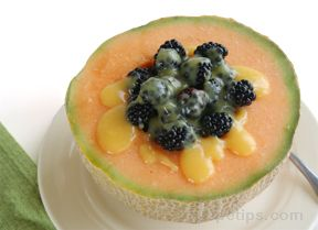 Blackberry filled Cantaloupe with Orange Sauce