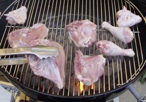 ' ' from the web at 'http://files.recipetips.com/kitchen/images/refimages/grilling/charcoal/whitechicken.jpg'