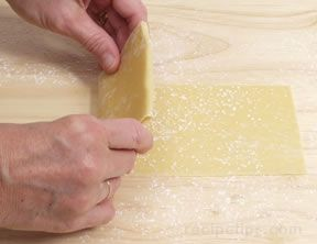 cutting and shaping pasta by hand Article